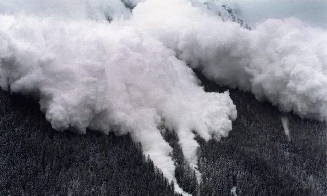 An aerial view of one of two avalanches making its way through the landscape as it hits the Swiss ski resort of Evolene in the Swiss Alps, on Feb. 22, 1999. (Fabrice Coffrini/AFP/Getty Images)