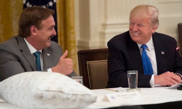President Donald Trump shakes hands with Mike Lindell (L), founder of MyPillow, during a Made in America event with U.S. manufacturers in the East Room of the White House in Washington, on July 19, 2017. (Saul Loeb/AFP/Getty Images)