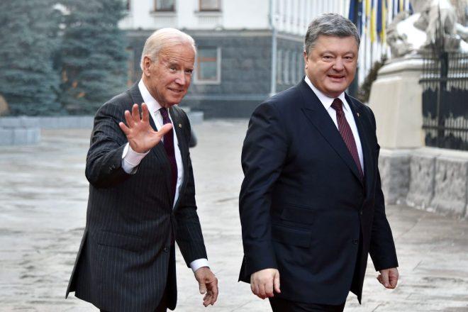Joe biden is welcomed by Ukrainian president Petro Poroshenko