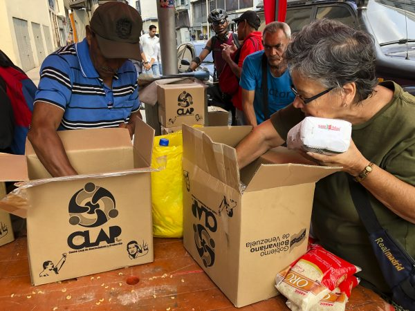 Neighbors of barrio Union of Petare open boxes of food program CLAP in Caracas, Venezuela