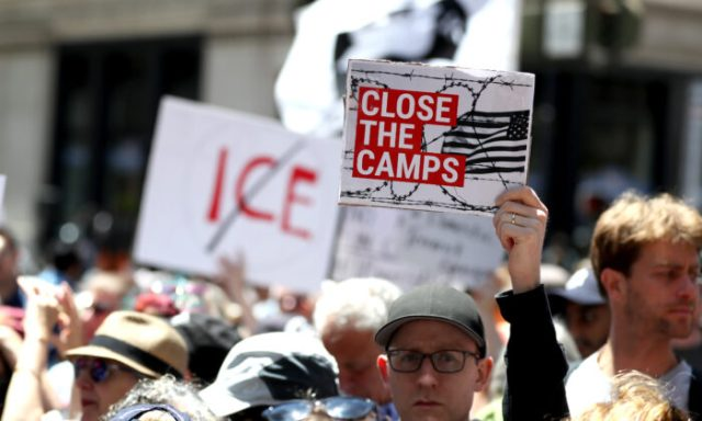 Protesters hold signs during a demonstration against migrant detention facilities on July 2, 2019 in San Francisco, Calif. (Justin Sullivan/Getty Images)
