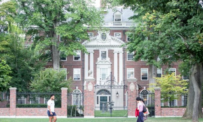 Pedestrians walk past a Harvard University building in Cambridge, Mass., on Aug. 30, 2018. (Scott Eisen/Getty Images)