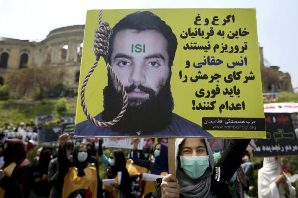 protester holds a poster with Persian