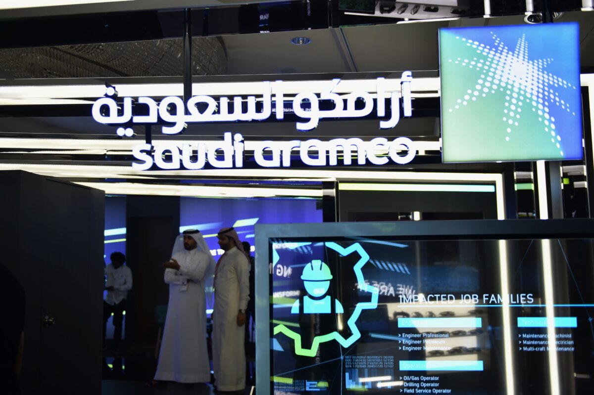 Visitors stop at the Aramco exhibition