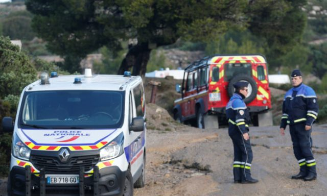French police secure the area around the site where a helicopter from the civil security services crashed while en route to help people caught up in heavy flooding, in Le Rove near Les-Pennes-Mirabeau, France, Dec. 2, 2019. (Jean-Paul Pelissier/Reuters)
