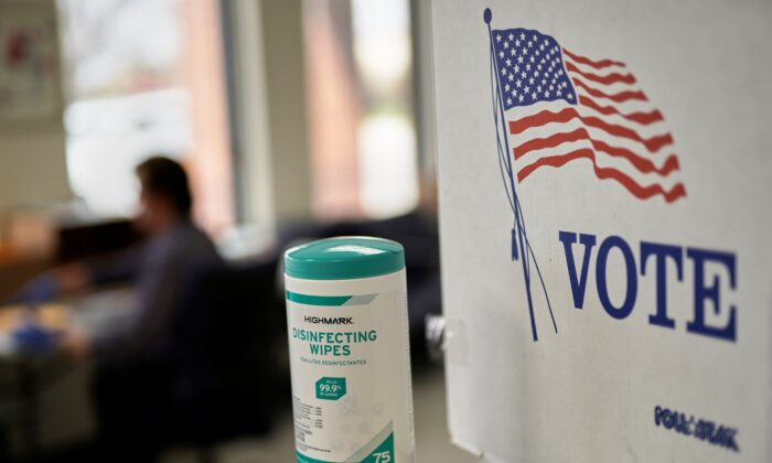 File photo of a voting booth. (Nati Harnik/AP Photo)