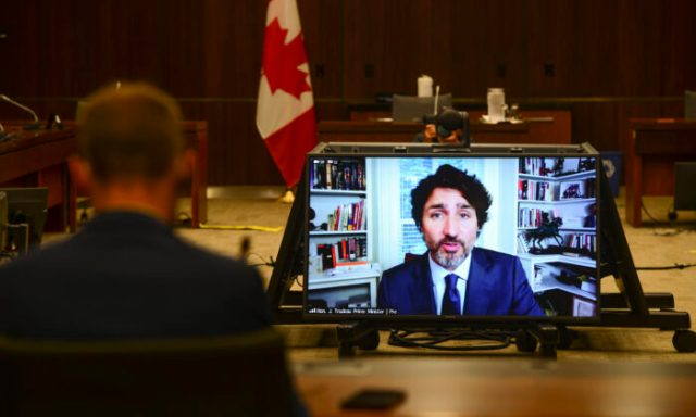 The WE controversy that has been dogging the Liberals is expected to continue to follow Prime Minister Justin Trudeau and his government after Trudeau's appearance before a House of Commons committee Thursday. Prime Minister Justin Trudeau appears as a witness via videoconference during a House of Commons finance committee in the Wellington Building on July 30, 2020. (The Canadian Press/Sean Kilpatrick)