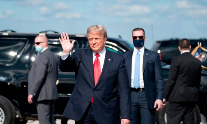 Outgoing President Donald Trump waves after landing at Palm Beach International Airport in West Palm Beach, Fla., on Jan. 20, 2021. (Alex Edelman/AFP via Getty Images)