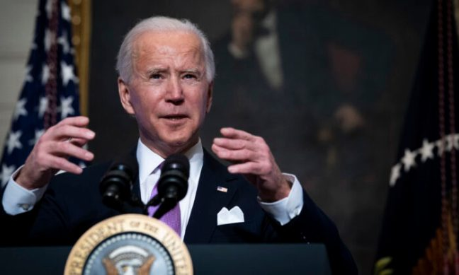 President Joe Biden speaks about the coronavirus pandemic in the State Dining Room of the White House in Washington on Jan. 26, 2021. (Doug Mills-Pool/Getty Images)