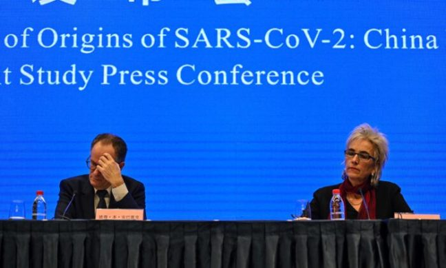 Peter Ben Embarek (L) and Marion Koopmans (R) attend a press conference to wrap up a visit by an international team of experts from the World Health Organization (WHO) in the city of Wuhan, in China's Hubei province on Feb. 9, 2021. (Hector Retamal/AFP via Getty Images)