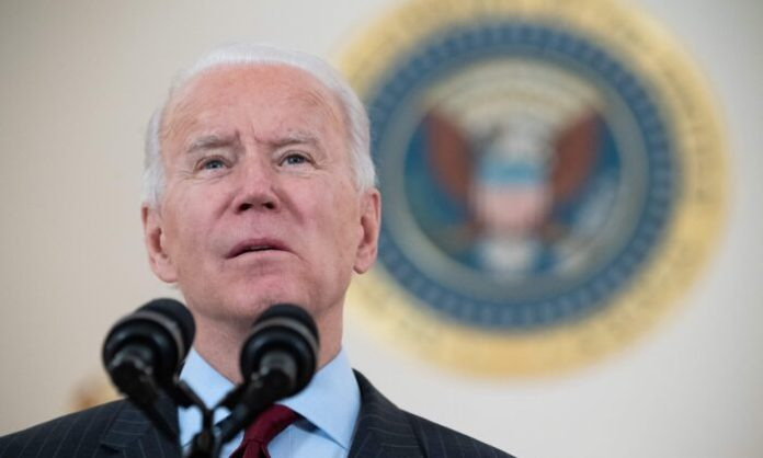 U.S. President Joe Biden speaks about American lives lost to COVID-19 as the national death toll passes 500,000 from the Cross Hall of the White House in Washington, on Feb. 22, 2021. (Saul Loeb/AFP via Getty Images)