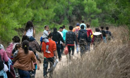 Illegal immigrants, most from Honduras, walk toward a U.S. Border Patrol checkpoint after crossing the Rio Grande from Mexico near Mission, Texas, on March 23, 2021. (John Moore/Getty Images)