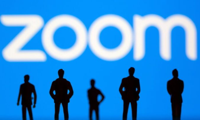 Small toy figures are seen in front of a Zoom logo in this illustration picture taken on March 15, 2021. (Dado Ruvic/Illustration/Reuters/File Photo)