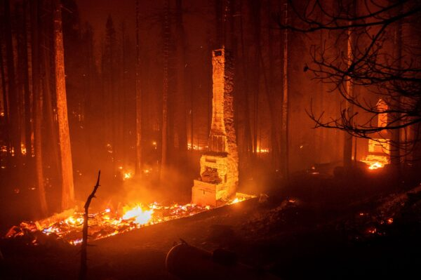 The chimney stands beside the Caldo fire