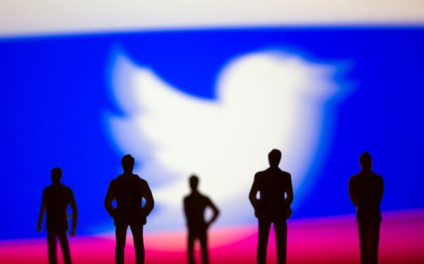 twitter logo and russian flag