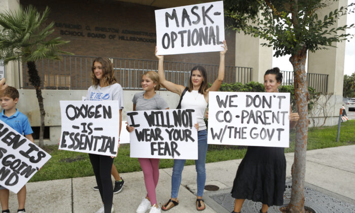 Families protest any potential mask mandates before the Hillsborough County Schools Board meeting held at the district office on July 27, 2021 in Tampa, Florida. (Octavio Jones/Getty Images)