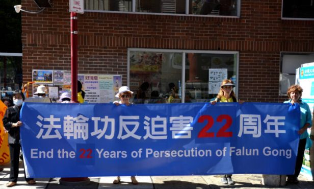 People participate in a rally to denounce the Chinese Communist Party (CCP) and encourage Chinese people to withdraw from the CCP and its affiliated organizations, in Philadelphia Chinatown, on Sept. 26, 2021. (Frank Liang/The Epoch Times)
