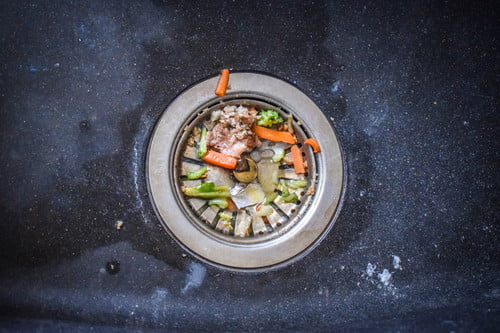 how to unclog a garbage disposal system