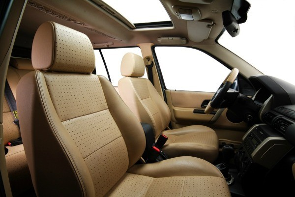 The Interior Of A Car With Brown Leather Seats