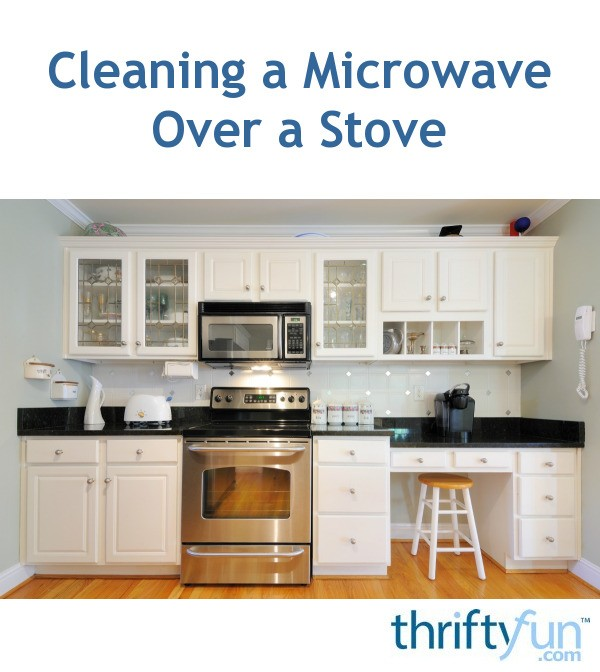 cleaning a microwave over a stove