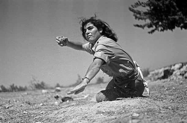 During the War of Independence, 1948, a woman receives basic training in grenade throwing