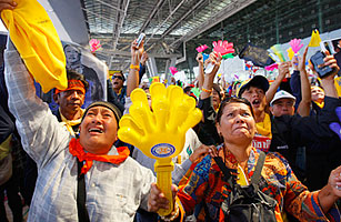 People's Alliance for Democracy (PAD) protesters celebrate at Bangkok's besieged Suvarnabhumi international airport on Dec. 2, 2008