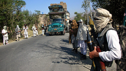 Pakistani pro-Taliban militants stand with their weapons on a street in Swat Valley in 2007