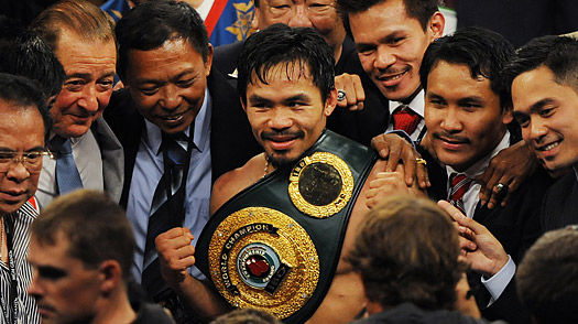 Manny Pacquiao celebrates with team members after knocking out Ricky Hatton to win their Welterweight title fight at the MGM Grand Garden Arena on May 2, 2009 in Las Vegas.