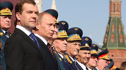 Russian President Dmitry Medvedev, Prime Minister Vladimir Putin, stand with World War II veterans during the annual Victory Day parade on Moscow's Red Square.