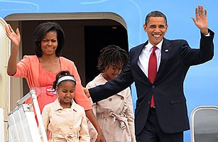 US President Barack Obama along with his wife Michelle and daughters Sasha and Malia wave upn their arrival to Moscow on July 6, 2009.