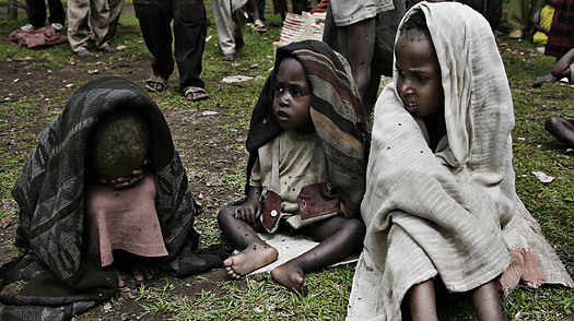 Children wait at an Outpatient Treatment Center for treatment on June 10, 2008 in Lerra village, southern Ethiopia.