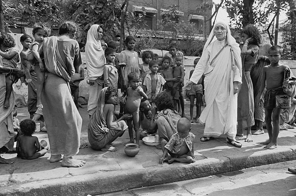 Assisting the poor and the disadvantaged on a street in India.