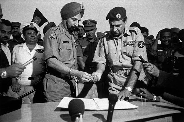 December 16, 1971: Pakistan's Gen. A.A.K. Niazi, right, signs instrument of surrender with Indian Gen. Jagjit Singh Aurora. With nearly 100,000 lakh POWs, it is ther biggest surrender in 20th century.     Source, courtesy & more: http://www.time.com/time/photogallery/0,29307,1844754,00.html#ixzz1qGDC4WLj     Click for image.
