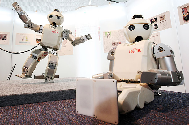 Fujitsu's HOAP-3 can walk, grasp objects and carry on a simple conversation.