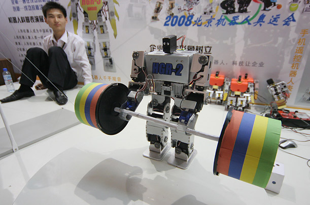 A robot lifts weights at the 10th China Beijing International High-Tech Expo.