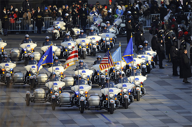 Washington police sweep down the parade route before President Obama