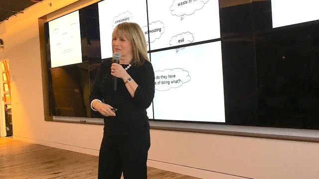 Middle aged woman standing up giving a presentation, women over 50, career, Next Avenue