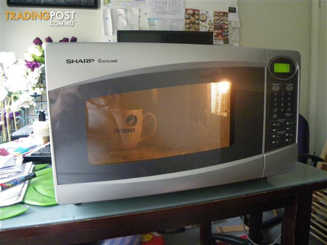 sharp carousel midsize microwave oven 1100watt 320mm diameter r 330j s
