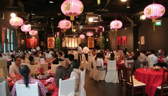 tourists and locals dine at the famous Chef Chan restaurant