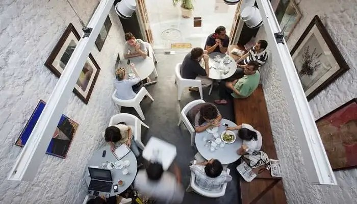 Top view of people sitting together having food at Kala Ghoda Cafe in Mumbai