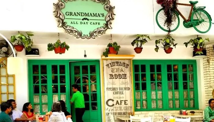 People sitting outside Grandmama's All Day Cafe in Mumbai