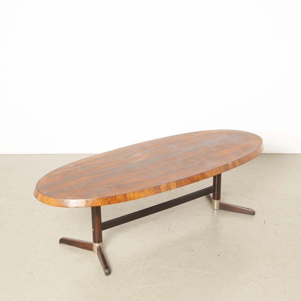 oval coffee table in dark tropical hardwood