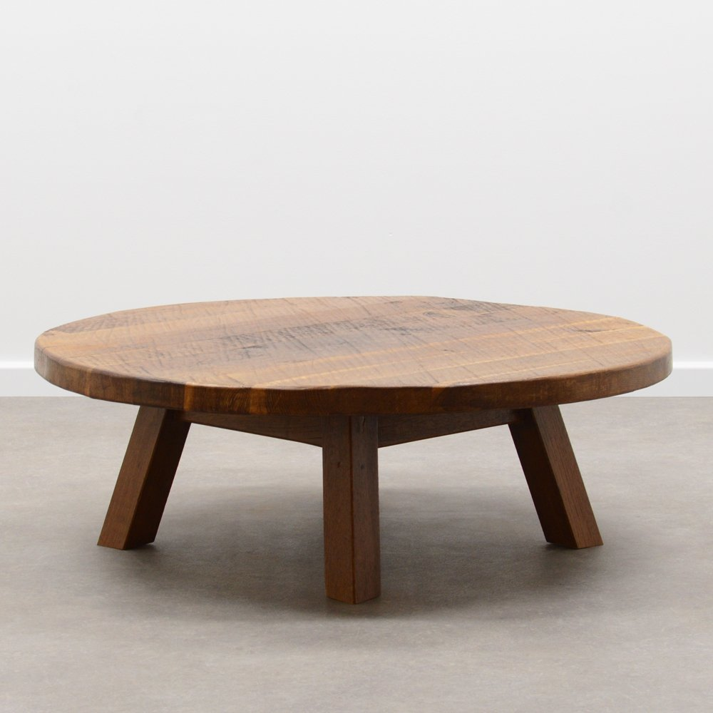 round brutalist coffee table in solid oak