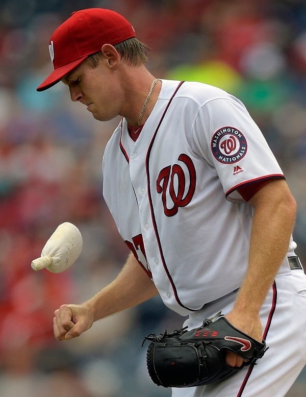 WASHINGTON DC, JULY 3: Washington's starting pitcher Stephen Strasburg (37), uses the rosin bag; coming back form an injury, tossing a no- hitter, till he was pulled from the game with a high pitch count. He pitched 6 and 2/3 innings during the Washington Nationals defeat of the Cincinnati Reds 12 -1 at Nationals Park in Washington DC, July 3, 2016. (Photo by John McDonnell / The Washington Post)