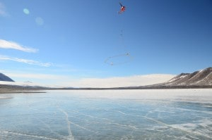 A helicopter flies the AEM sensor over Lake Frxyell in the McMurdo Dry Valleys, Antarctica. (L. Jansan)