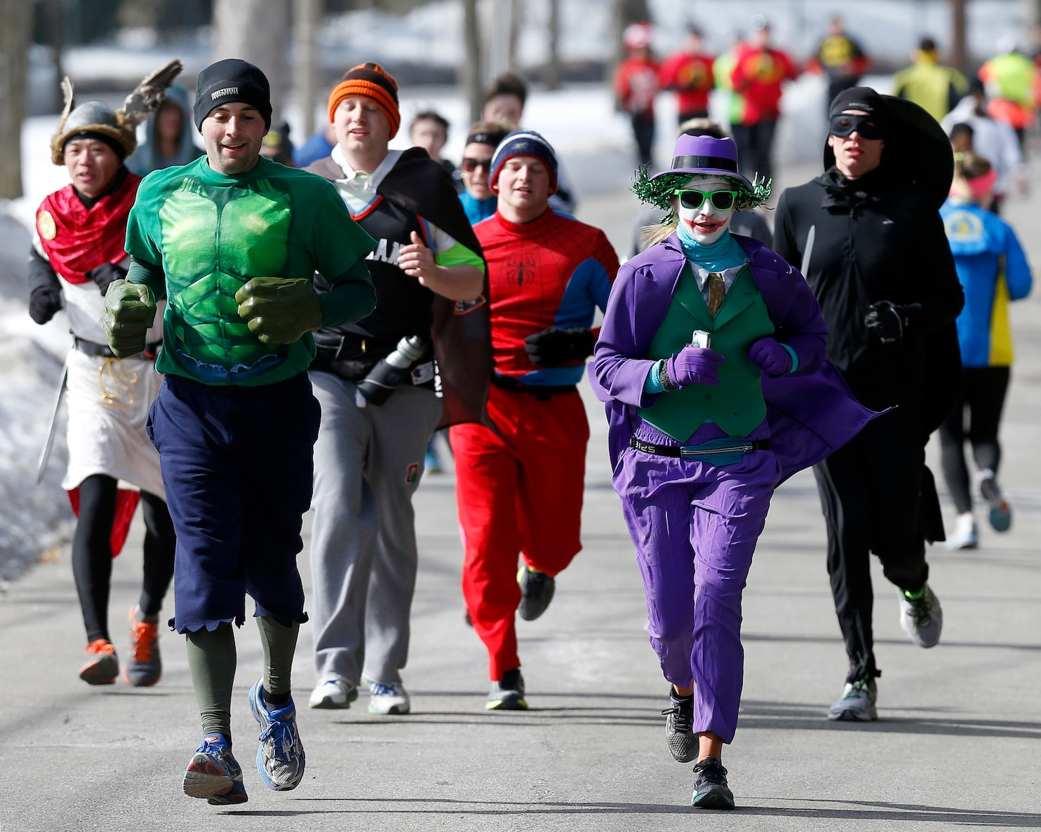 Runners In Superhero Costumes Prepare For Boston Marathon