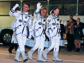 Russian Cosmonauts Alexander Misurkin, right, Pavel Vinogradov, center, and U.S. astronaut Christopher Cassidy, crew members of the mission to the International Space Station, ISS, walk prior the launch of Soyuz-FG  rocket at the Russian leased Baikonur Cosmodrome, Kazakhstan, Thursday, March 28, 2013.  (AP Photo/Dmitry Lovetsky, Pool)