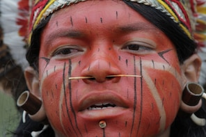 A Pataxo Indian takes part in the first day of  the National Indigenous Mobilization protest in Brasilia, Brazil, Tuesday, Oct. 1, 2013. The protest is against a proposed constitutional amendment known as PEC 215, which amends the rules for demarcation of indigenous lands. (AP Photo/Eraldo Peres)