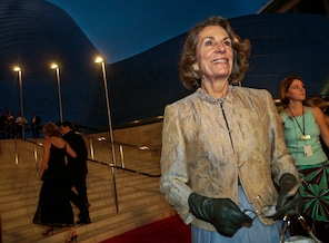 FILE - In this Oct. 23, 2003 file photo, Diane Disney Miller poses for photographers as she arrives for a grand opening concert gala at the new Walt Disney Concert Hall in Los Angeles. Disney Miller, the daughter of Walt Disney and one of his inspirations for building the Disneyland theme park, has died at her home in Napa, California. She was 79. (AP Photo/Chris Pizzello, File)