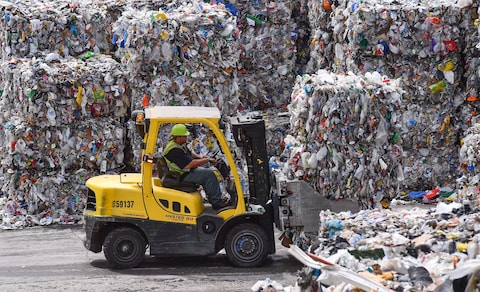 American recycling is stalling  and the big blue bin is one reason     A forklift operator stacks bales of recyclables at Waste Management s  facility in Elkridge  Md  The District and other local jurisdictions are  paying to